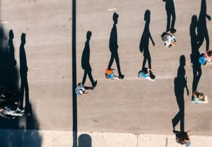 People walking with shadows to demonstrate the key takeaways from the 2016 ACA Risk Adjustment Individual market results