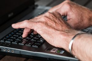 Hands typing to show exploration of the 2019 Medicare Advantage Annual Enrollment Period results