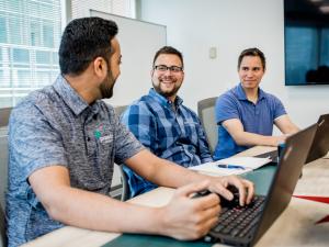 Pareto employees discussing healthcare analytics